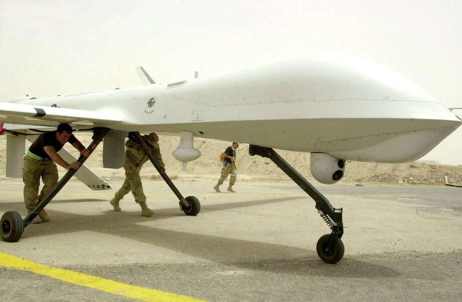 In this undated handout photo provided by the U.S. Air Force, airmen with the 64th Expeditionary Reconnaissance Squadron move an RQ-1 Predator Unmanned Aerial Vehicle at Tallil Air Base in Iraq. Photo: U.S. Air Force, Getty Images / 2003 Getty Images
