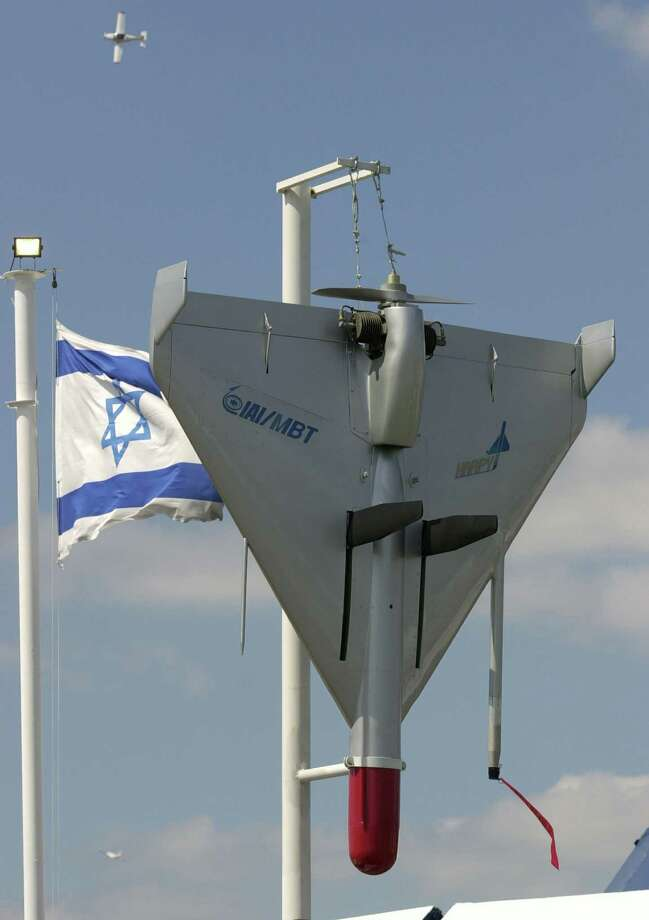 An Israeli flag flutters next to an Harpy IAI-MBT Attack Drone as part of the Israeli display during the 44th Paris Air Show on June 21, 2001. Photo: FRANCOIS MORI, AFP/Getty Images / 2001 Getty Images