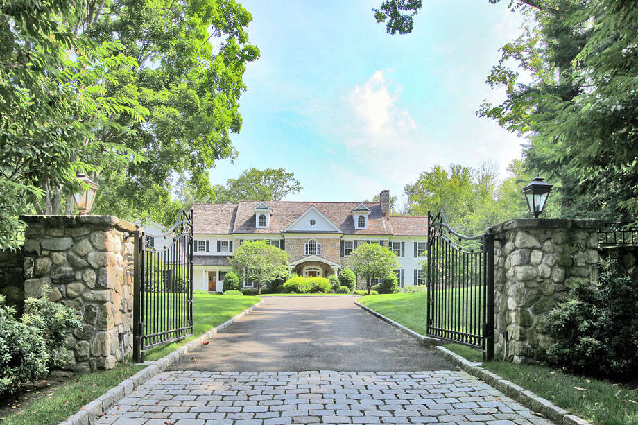 The stately 18-room Colonial has four finished levels and sits on nearly 3.5 acres. Photo: Contributed Photo / Westport News