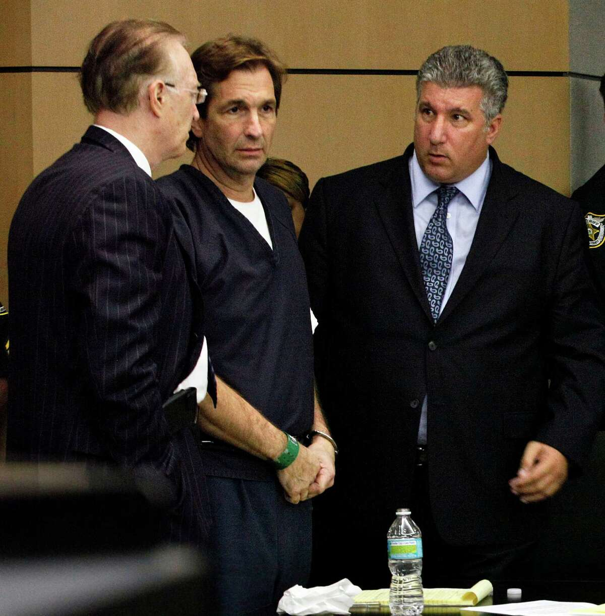 John Goodman, center, talks with his attorneys Roy Black and Guy Fronstin during his sentencing hearing on May 11 in West Palm Beach, Fla. (AP Photo/The Palm Beach Post, Lannis Waters, Pool)