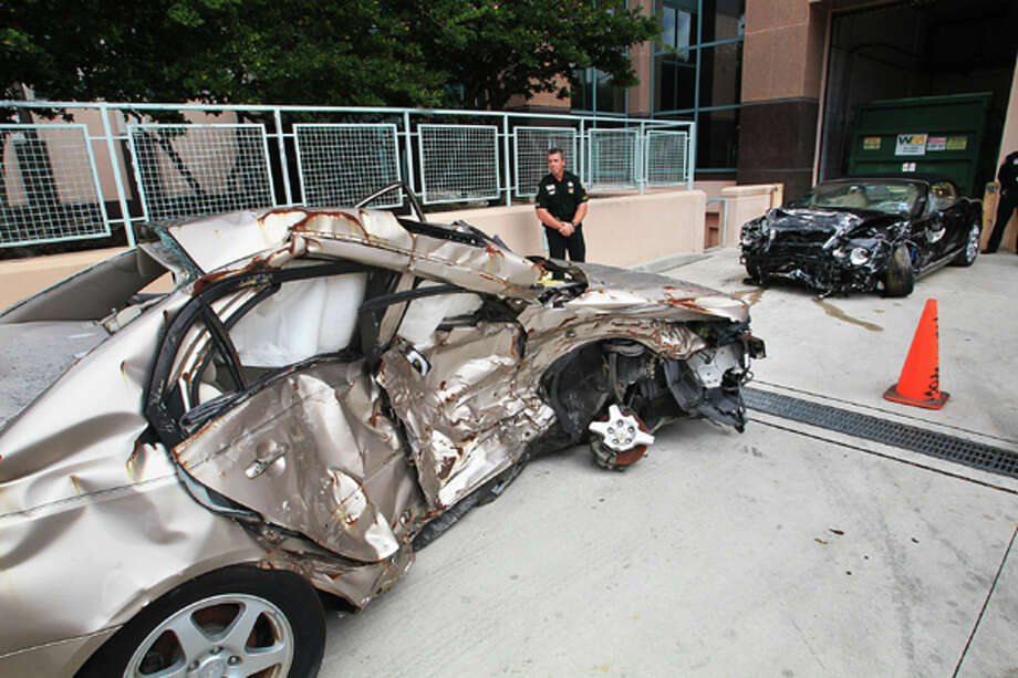 The crumpled car driven by Scott Wilson, left, and the Bentley driven by John Goodman, right,  the night of the crash that killed Scott Wilson was shown to jurors and entered as part of evidence in the Goodman's DUI Manslaughter trial on Thursday, March, 15, 2012, in West Palm Beach, Fla.  Goodman is accused of driving drunk and leaving the scene of the February 2010 crash that killed 23-year-old Scott Wilson. (AP Photo/The Palm Beach Post, Lannis Waters, Pool) Photo: Lannis Waters, Associated Press / Pool, Palm Beach Post
