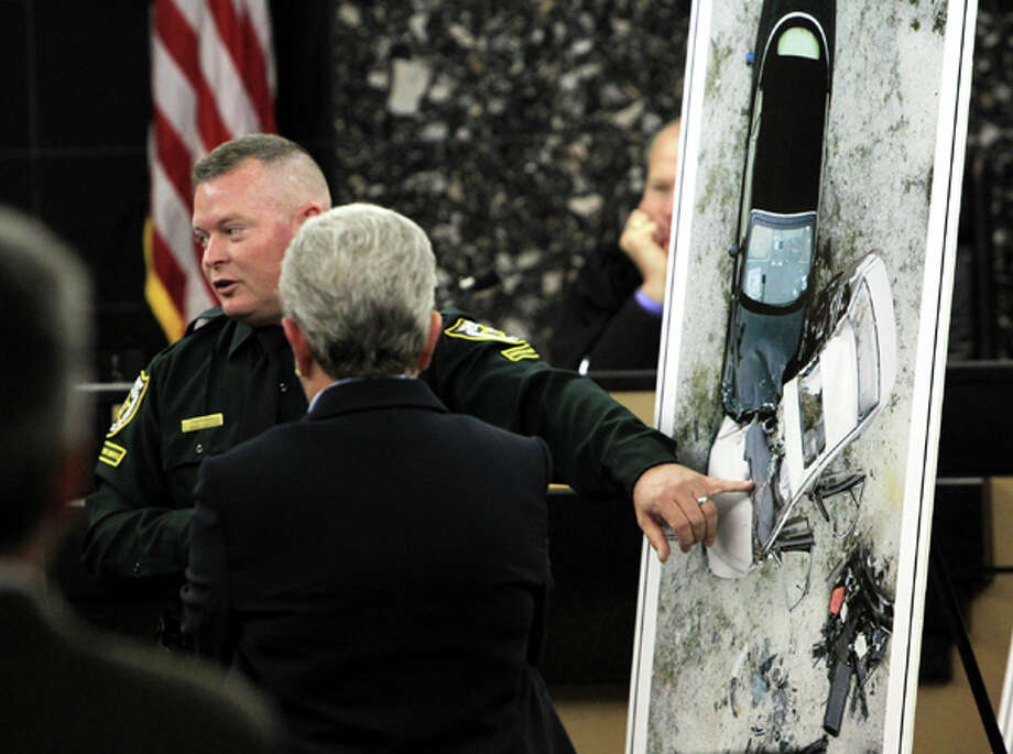 PBSO Corporal Troy Snelgrove talks about a photo showing a re-creation of the accident put together by investigators during John Goodman's DUI Manslaughter trial  on Thursday, March, 15, 2012, in West Palm Beach, Fla.  Goodman is accused of driving drunk and leaving the scene of the February 2010 crash that killed 23-year-old Scott Wilson. (AP Photo/The Palm Beach Post, Lannis Waters, Pool) Photo: Lannis Waters, Associated Press / Pool, Palm Beach Post