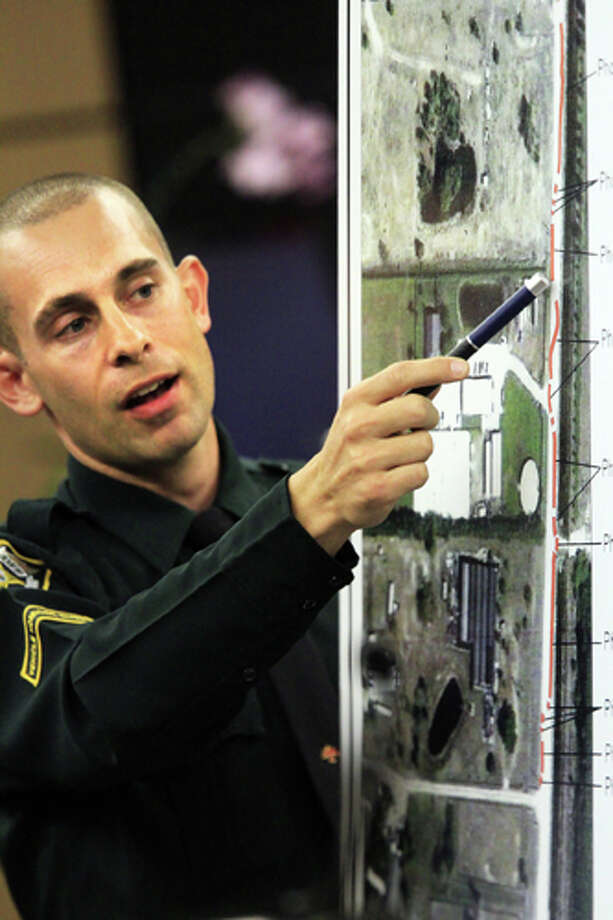 Deputy Robert Stephan points out the red line on an aerial photo of the road that shows the path that John Goodman walked from the crash scene to Lisa Pembleton's trailer, as he testifies in court, Friday, March, 16, 2012, in West Palm Beach, Fla. Goodman is accused of driving drunk and leaving the scene of the February 2010 crash that killed 23-year-old Scott Wilson. (AP Photo/The Palm Beach Post, Lannis Waters, Pool) Photo: Lannis Waters, Associated Press / The Palm Beach Post, Pool