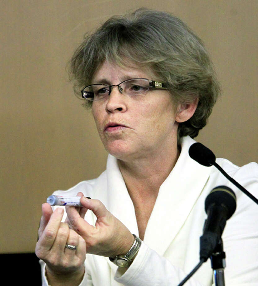 Cecelia Betts, an registered nurse at Wellington Regional Medical Center, shows the vial she used to draw blood from John Goodman for the police investigation, as she testifies in court in Goodman's DUI manslaughter trial, Friday, March, 16, 2012, in West Palm Beach, Fla.. Goodman was brought to the medical center to be treated the night of the crash. Goodman is accused of driving drunk and leaving the scene of the February 2010 crash that killed 23-year-old Scott Wilson. (AP Photo/The Palm Beach Post, Lannis Waters, Pool) Photo: Lannis Waters, Associated Press / The Palm Beach Post, Pool