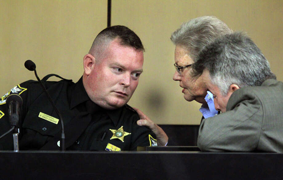Prosecutor Ellen Roberts, center, and defense attorney Mark Shapiro, right, talk with PBSO Corporal Troy Snelgrove who is testifying in the John Goodman DUI Manslaughter trial on Thursday, March, 15, 2012, in West Palm Beach, Fla.  Goodman is accused of driving drunk and leaving the scene of the February 2010 crash that killed 23-year-old Scott Wilson. (AP Photo/The Palm Beach Post, Lannis Waters, Pool) Photo: Lannis Waters, Associated Press / Pool, Palm Beach Post