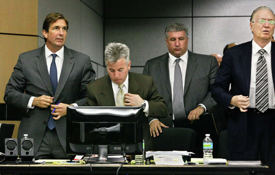 John Goodman, left, and his attorneys, from second left, Mark Shapiro, Guy Fronstin, and Roy Black, right, stand as the jury enters the courtroom on the first day of his DUI Manslaughter trial on Tuesday, March 13, 2012 in West Palm Beach, Fla. Goodman is accused of driving drunk and leaving the scene of the February 2010 crash that killed 23-year-old Scott Wilson. (AP Photo/The Palm Beach Post, Lannis Waters, Pool) Photo: Lannis Waters, Associated Press / OUT TV, MAGAZINES.  NO SALES.