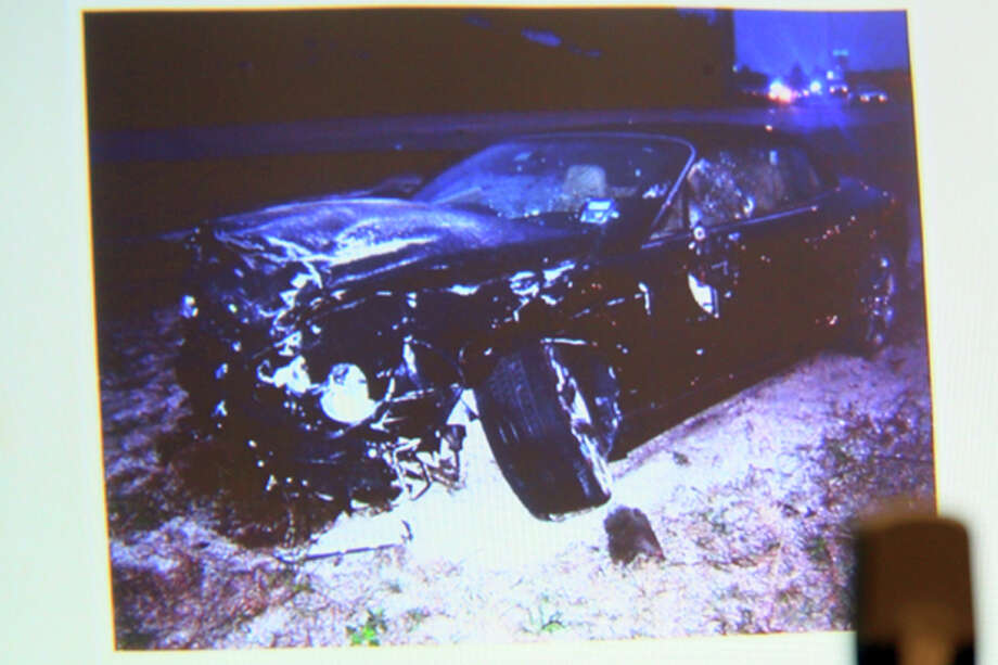 Photo on display is presented in court of John Goodman's Bentley from the crash scene during John Goodman's trial on Wednesday, March 14, 2012 , in West Palm Beach, Fla. Goodman, the founder of the International Polo Club Palm Beach, is accused of driving drunk and leaving the scene of the February 2010 crash that killed 23-year-old Scott Wilson. (AP Photo/The Palm Beach Post, Lannis Waters, Pool) Photo: Lannis Waters, Associated Press / Pool, Palm Beach Post