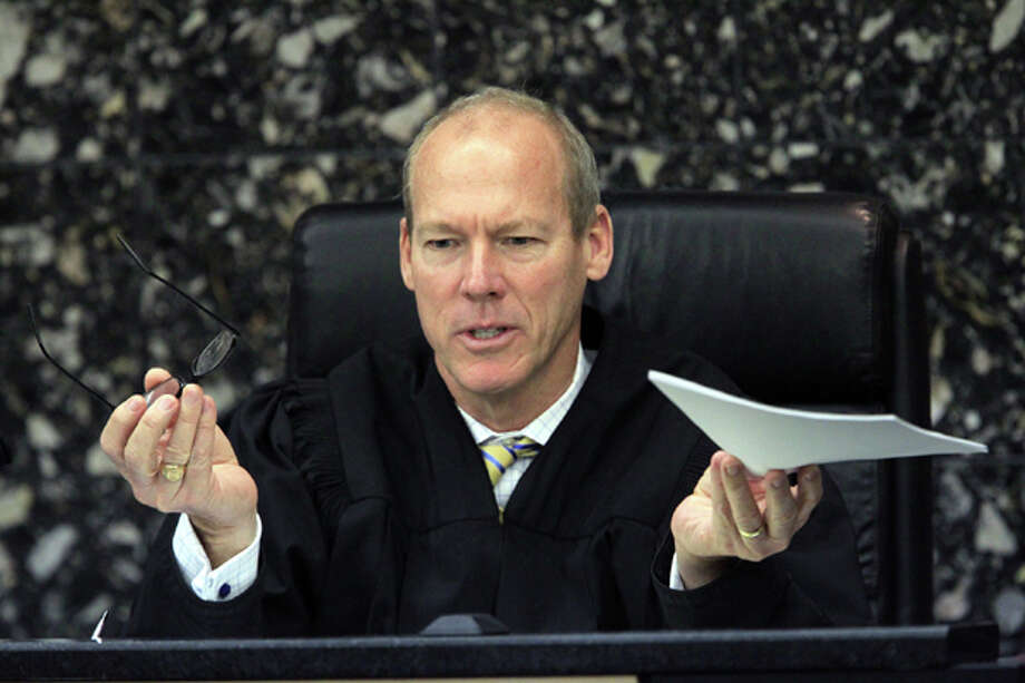 Judge Jeffrey Colbath talks to attorneys during John Goodman's trial on Wednesday, March 14, 2012 , in West Palm Beach, Fla. Goodman, the founder of the International Polo Club Palm Beach, is accused of driving drunk and leaving the scene of the February 2010 crash that killed 23-year-old Scott Wilson. (AP Photo/The Palm Beach Post, Lannis Waters, Pool) Photo: Lannis Waters, Associated Press / Pool, Palm Beach Post