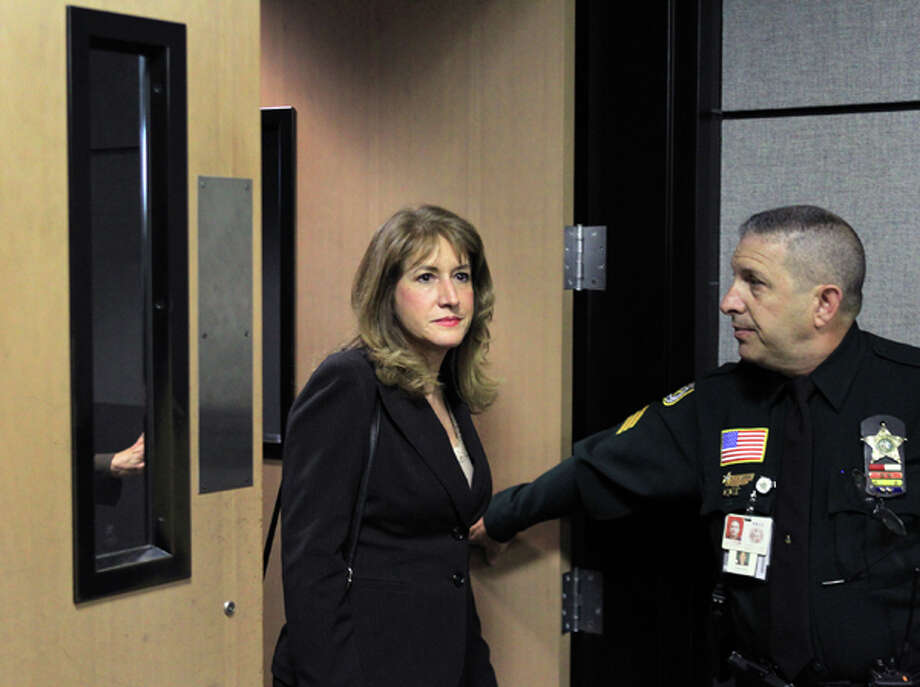 Lili Wilson, left, mother of Scott Wilson, enters the courtroom for first day of the DUI manslaughter trial of John Goodman in West Palm Beach, Fla., Tuesday, March 13, 2012. Goodman is accused of driving drunk and leaving the scene of the February 2010 crash that killed 23-year-old Scott Wilson.  (AP Photo/The Palm Beach Post, Lannis Waters, Pool) Photo: Lannis Waters, Associated Press / Pool, Palm Beach Post