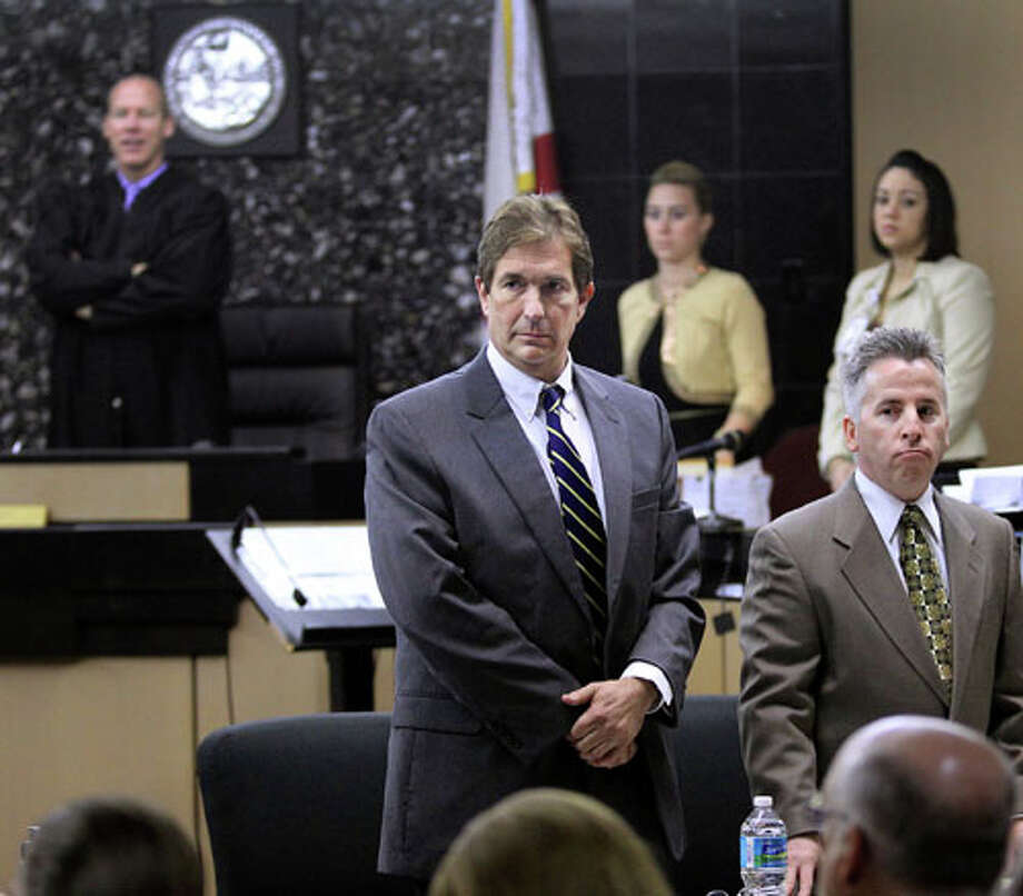 John Goodman, left, stands with attorney Mark Shapiro as the jury pool arrives for the second day of jury selection in his DUI manslaughter trialWednesday, March 7, 2012, in West Palm Beach, Fla. Goodman is accused of driving drunk and leaving the scene of the February 2010 crash that killed 23-year-old Scott Wilson. (AP Photo/Palm Beach Post, Lannis Waters, Pool) Photo: Lannis Waters, Associated Press / Palm Beach Post