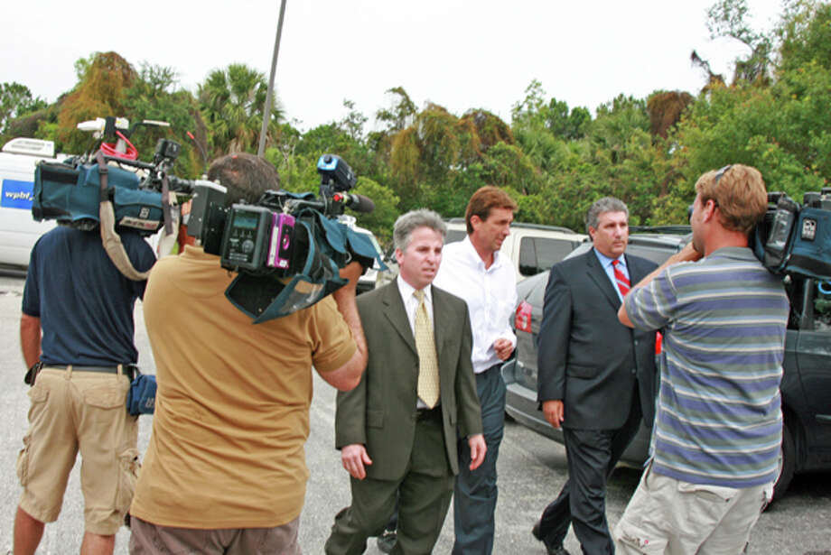 Elusive billionaire polo mogul John Goodman, accompanied by his lawyers, is released from Palm Beach County Jail at 2:30 Wednesday afternoon accompanied by his attorneys. EXCLUSIVE TO PALM BEACH DAILY NEWS Photo: Augustus Mayhw, Palm Beach Daily News / Ray Palm Beach Post