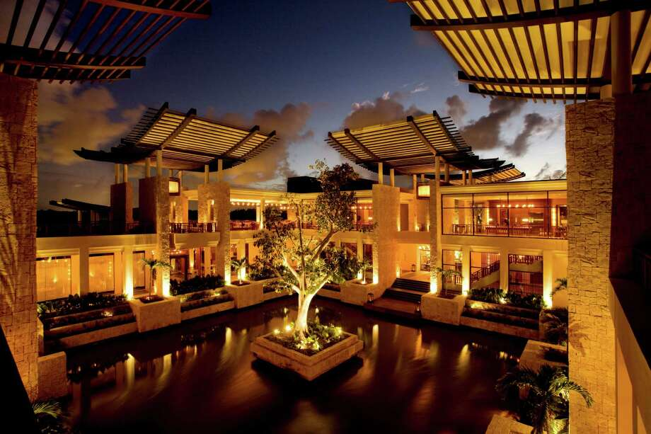 Clockwise, from left:  The open-air, water-enclosed lobby at the Banyan Tree Mayakoba. Boats cruise waterways around the resorts. Aromatherapy rules at the Rosewood's Sense spa.