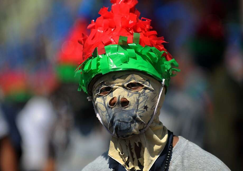 "A man plays as a ""Jew of Masatepe"" in the procession called ''The chained'', during which they chase and capture other people --dressed as Judas-- to drag them chained along the streets as punishment for betraying Jesus Christ, as part of the activities of Holy Week, in Masatepe, 50 km south of Managua, on March 28, 2013. AFP PHOTO/Hector RETAMALHECTOR RETAMAL/AFP/Getty Images Photo: Hector Retamal, AFP/Getty Images"