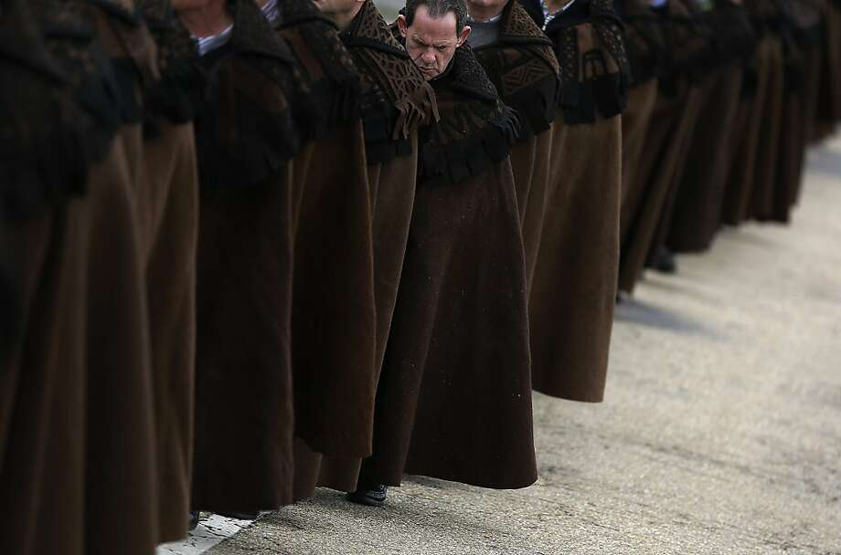 "Penitents take part in the procession of ""Santo Cristo"" during Holy Week in Bercianos de Aliste, northern Spain, Thursday, March 28, 2013. Hundreds of processions take place throughout Spain during the Easter Holy Week. (AP Photo/Andres Kudacki). Photo: Andres Kudacki, Associated Press"