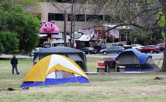Camp sites start to pop up around Brackenridge Park on Thursday, Mar. 28, 2013.  Photo: Kin Man Hui, San Antonio Express-News / © 2012 San Antonio Express-News