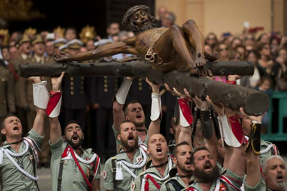Members of the Spanish Legion carry a statue of the Christ of the Good Death to the Santo Domingo de Guzman church during a Holy Week procession in Malaga, southern Spain, on March 28, 2013. Christian believers around the world mark the Holy Week of Easter in celebration of the crucifixion and resurrection of Jesus Christ.   AFP PHOTO/ JORGE GUERREROJorge Guerrero/AFP/Getty Images Photo: Jorge Guerrero, AFP/Getty Images