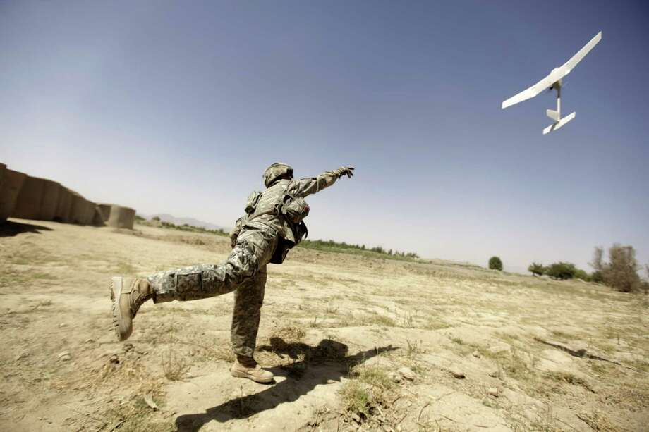A U.S. Army soldier tries to launch a drone on September 4, 2010 in Afghanistan. Photo: PATRICK BAZ, AFP/Getty Images / 2010 AFP