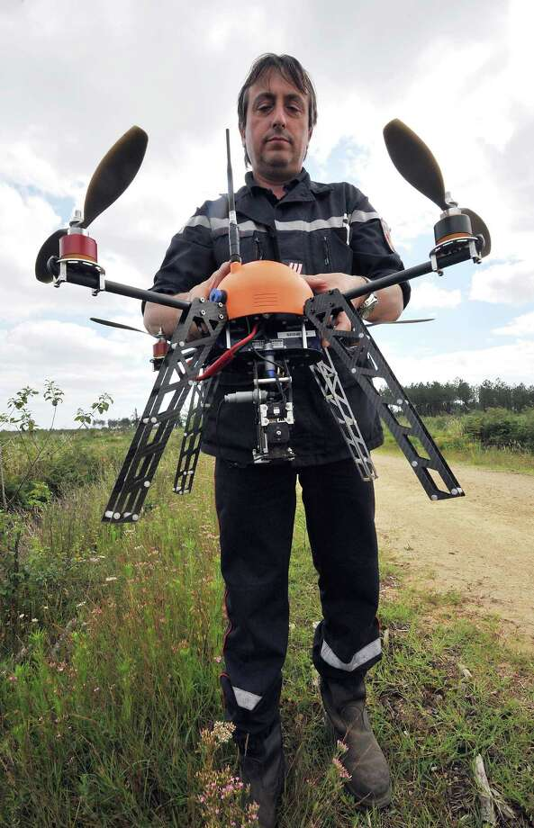 A French firefighter holds a French Fly-n-Sense drone before its take off on July 12, 2012 on a test flight. The drone is designed to enable a real-time monitoring of forest fires. Photo: PIERRE ANDRIEU, AFP/Getty Images / 2012 AFP
