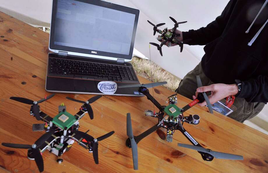 "An employee of ENAC company handles Blender drones on September 26, 2012 in Merignac near Bordeaux, France, during the ""UAV Show Europe."" Photo: PIERRE ANDRIEU, AFP/Getty Images / 2012 AFP"