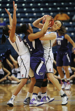 Kansas State's Mariah White, center, is tied up by UConn's Kelly Faris, right, after being double teamed by Faris and Bria Hartley, left,  in the second round of the NCAA women's basketball tournament at the Webster Bank Arena in Bridgeport on Monday, March 19, 2012. Photo: Brian A. Pounds / Connecticut Post