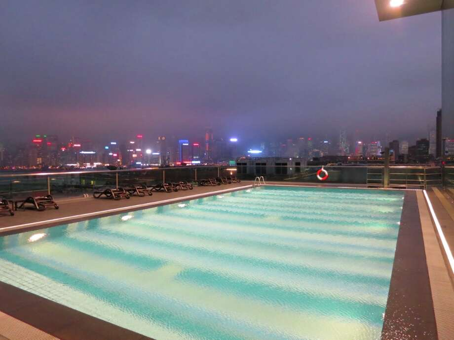 Warm pool on a cloudy night at Hotel Icon Hong Kong overlooking the Harbour