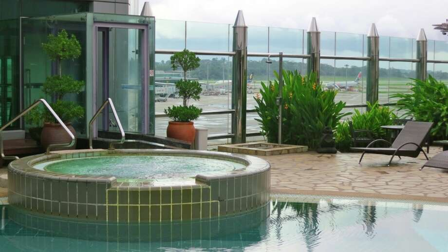 Guests at Singapore's Changi Airport have access to the airport pool and hot tub-- with a view of runways!