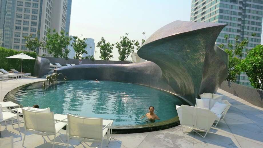 If you looked down on this pool from the tower of the W hotel Bangkok, you would see a big blue eye-- and the black sculpture would be the eyebrow. Wow!
