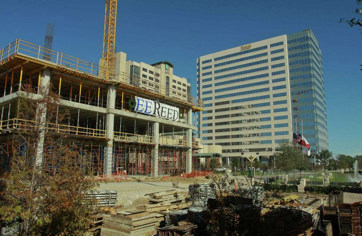 (For the Chronicle/Gary Fountain, December 20, 2012) Energy Tower III under construction, from left, Hilton Embassy Suites Hotel, and Energy Tower II on the northwest corner of Interstate 10 and Kirkwood.