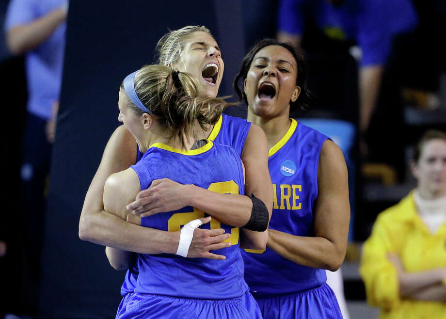 Delaware's Lauren Carra, from left, Elena Delle Donne and Jaquetta May celebrate after beating North Carolina in a second-round game in the women's NCAA college basketball tournament in Newark, Del., Tuesday, March 26, 2013. (AP Photo/Patrick Semansky) Photo: Patrick Semansky, Associated Press / AP