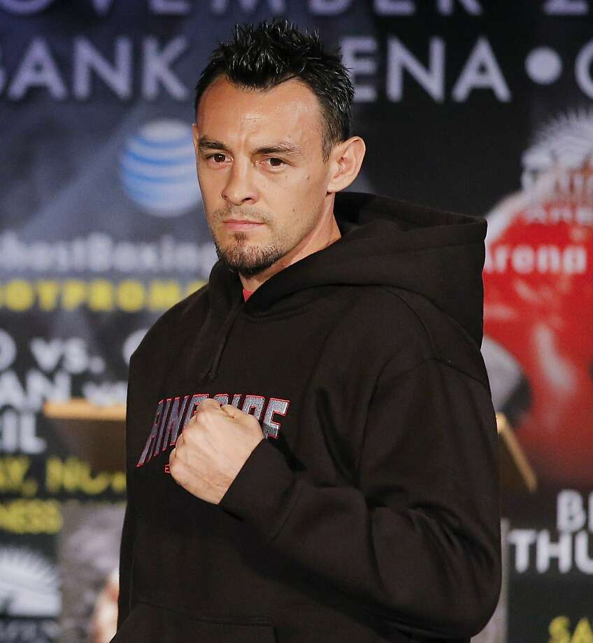 In this Oct. 23, 2012 file photo, boxer Robert Guerrero is photographed during a news conference in Los Angeles. Guerrero was arrested at New York's Kennedy Airport after police said he tried to bring a gun on a plane. Queens District Attorney Richard Brown said Guerrero was arrested Thursday, March 28, 2013, when he presented a locked gun box to a ticket agent during check-in. The 30-year-old Guerrero is the former featherweight champion and current WBC welterweight champion. (AP Photo/Jae C. Hong, file) Photo: Jae C. Hong, Associated Press