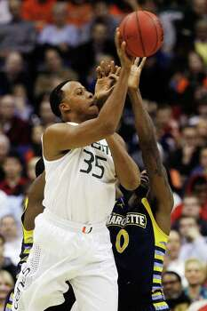Miami's Kenny Kadji (35) shoots over Marquette's Jamil Wilson (0) during the first half of an East Regional semifinal in the NCAA college basketball tournament, Thursday, March 28, 2013, in Washington. (AP Photo/Pablo Martinez Monsivais) Photo: Pablo Martinez Monsivais, Associated Press / AP