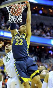Marquette guard Trent Lockett (22) dunks over Miami guard Rion Brown (15) in the first half of an NCAA Tournament East Regional semifinal at the Verizon Center in Washington, D.C., Thursday, March 28, 2013. (Mark Gail/MCT) Photo: Mark Gail, McClatchy-Tribune News Service / MCT
