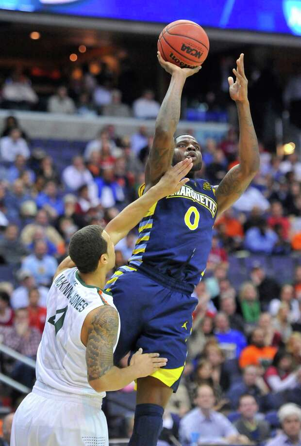 Marquette forward Jamil Wilson (0) shoots over Miami guard Trey McKinney Jones (4) in the first half of an NCAA Tournament East Regional semifinal at the Verizon Center in Washington, D.C., Thursday, March 28, 2013. (Mark Gail/MCT) Photo: Mark Gail, McClatchy-Tribune News Service / MCT