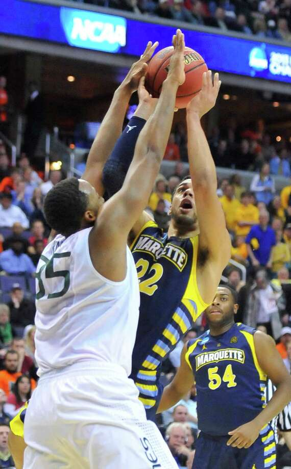 Marquette guard Trent Lockett (22) takes the ball up against Miami forward Kenny Kadji (35) in the first half of an NCAA Tournament East Regional semifinal at the Verizon Center in Washington, D.C., Thursday, March 28, 2013. (Mark Gail/MCT) Photo: Mark Gail, McClatchy-Tribune News Service / MCT