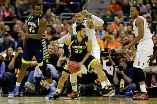 WASHINGTON, DC - MARCH 28:  Trent Lockett #22 of the Marquette Golden Eagles handles the ball against Julian Gamble #45 of the Miami (Fl) Hurricanes during the East Regional Round of the 2013 NCAA Men's Basketball Tournament at Verizon Center on March 28, 2013 in Washington, DC. Photo: Rob Carr, Getty Images / 2013 Getty Images