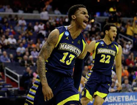 WASHINGTON, DC - MARCH 28:  Vander Blue #13 of the Marquette Golden Eagles reacts after a dunk against the Miami (Fl) Hurricanes during the East Regional Round of the 2013 NCAA Men's Basketball Tournament at Verizon Center on March 28, 2013 in Washington, DC. Photo: Rob Carr, Getty Images / 2013 Getty Images