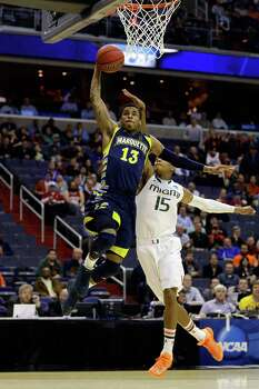 WASHINGTON, DC - MARCH 28:  Vander Blue #13 of the Marquette Golden Eagles goes to the hoop past Rion Brown #15 of the Miami (Fl) Hurricanes during the East Regional Round of the 2013 NCAA Men's Basketball Tournament at Verizon Center on March 28, 2013 in Washington, DC. Photo: Rob Carr, Getty Images / 2013 Getty Images