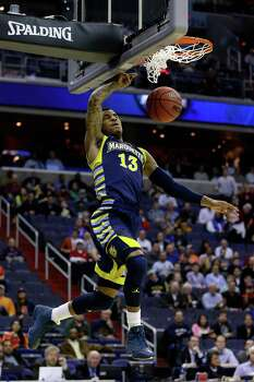 WASHINGTON, DC - MARCH 28:  Vander Blue #13 of the Marquette Golden Eagles dunks against the Miami (Fl) Hurricanes during the East Regional Round of the 2013 NCAA Men's Basketball Tournament at Verizon Center on March 28, 2013 in Washington, DC. Photo: Rob Carr, Getty Images / 2013 Getty Images