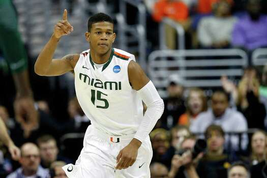 WASHINGTON, DC - MARCH 28:  Rion Brown #15 of the Miami (Fl) Hurricanes reacts against the Marquette Golden Eagles during the East Regional Round of the 2013 NCAA Men's Basketball Tournament at Verizon Center on March 28, 2013 in Washington, DC. Photo: Rob Carr, Getty Images / 2013 Getty Images