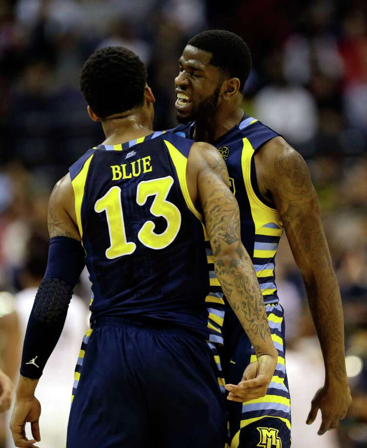 WASHINGTON, DC - MARCH 28:  Jamil Wilson #0 and Vander Blue #13 of the Marquette Golden Eagles celebrate at the end of the half against the Miami (Fl) Hurricanes during the East Regional Round of the 2013 NCAA Men's Basketball Tournament at Verizon Center on March 28, 2013 in Washington, DC. Photo: Rob Carr, Getty Images / 2013 Getty Images