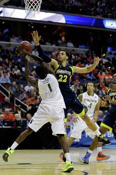 WASHINGTON, DC - MARCH 28:  Trent Lockett #22 of the Marquette Golden Eagles goes up for the block against Durand Scott #1 of the Miami (Fl) Hurricanes during the East Regional Round of the 2013 NCAA Men's Basketball Tournament at Verizon Center on March 28, 2013 in Washington, DC. Photo: Rob Carr, Getty Images / 2013 Getty Images