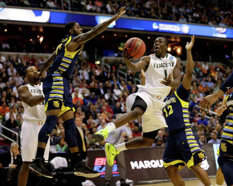 WASHINGTON, DC - MARCH 28:  Durand Scott #1 of the Miami (Fl) Hurricanes goes to the hoop against Jamil Wilson #0 of the Marquette Golden Eagles during the East Regional Round of the 2013 NCAA Men's Basketball Tournament at Verizon Center on March 28, 2013 in Washington, DC. Photo: Win McNamee, Getty Images / 2013 Getty Images