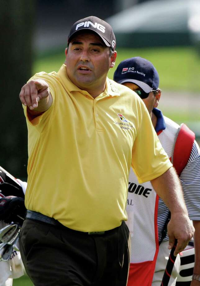 Angel Cabrera, from Argentina, points to the crowd as he walks onto the 16th green during the final round of the Bridgestone Invitational golf tournament Sunday, Aug. 9, 2009, at Firestone Country Club in Akron, Ohio. Cabrera finished tied for fourth place at 7-under par. (AP Photo/Mark Duncan) Photo: Mark Duncan, STF / AP