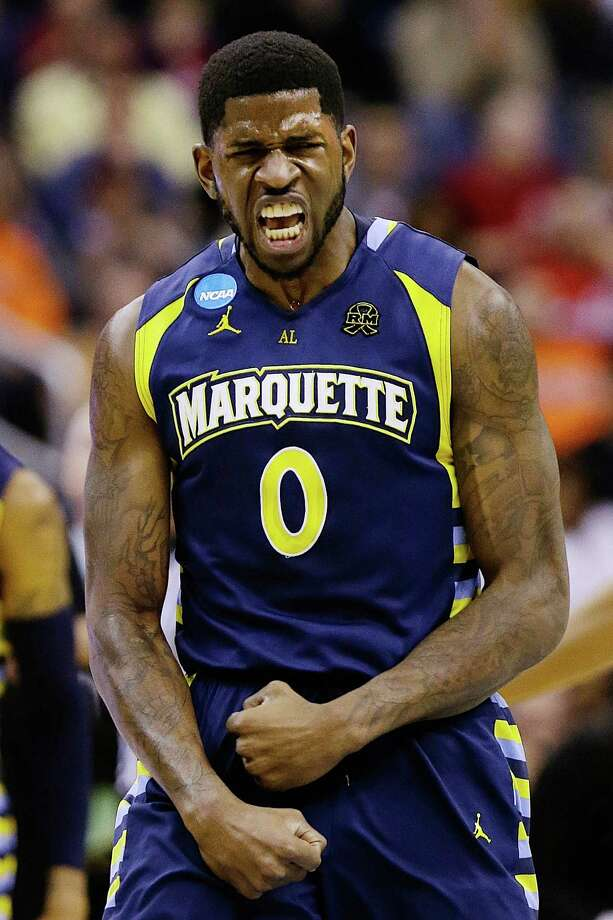 Marquette forward Jamil Wilson (0) reacts to a call during the first half of an East Regional semifinal in the NCAA college basketball tournament against Miami, Thursday, March 28, 2013, in Washington. (AP Photo/Alex Brandon) Photo: Alex Brandon, Associated Press / AP