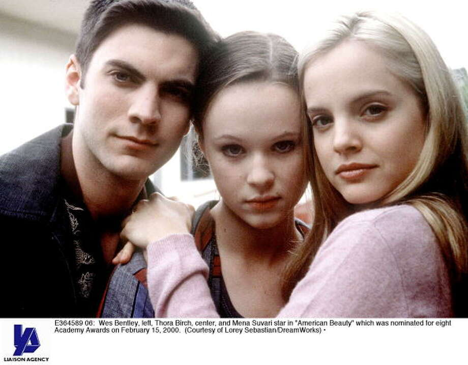 The two bookends here, Wes Bentley and Mena Suvari, were the tempters - one with marijuana and the other with .... well, you remember the movie. That's Thora Birch in the center. We disapprove of her decision to run off and live with a dealer! She was just a minor, after all. Photo: Getty Images / Getty Images North America
