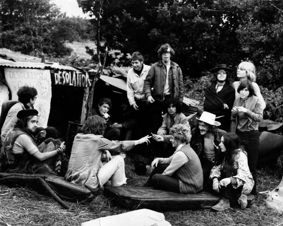 A group of Hippies talk and smoke marijuana outside their camp at the Isle of Wight pop festival on Aug. 1, 1969.Photo By Evening Standard/Getty Images