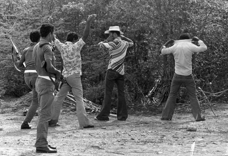 Armed police search suspected marijuana growers near Comejenes, Guajira Department, Colombia, circa 1980.Photo By Timothy Ross/Getty Images