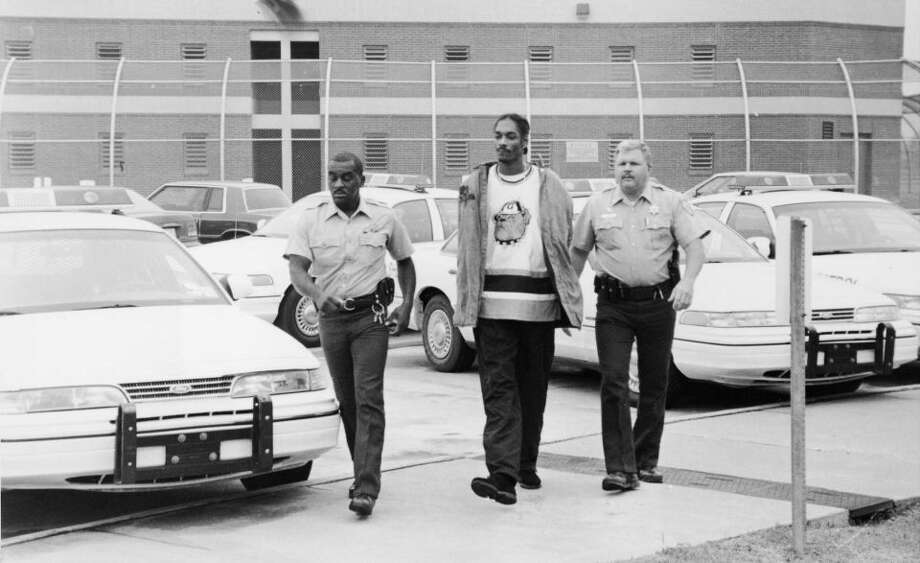 American rapper Snoop Dogg is escorted in handcuffs by two police officers following his arrest on charges of suspicion of possession of marijuana, circa 1995.Photo By Hulton Archive/Getty Images