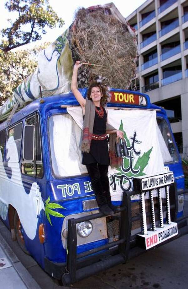 Mother-of-five Sonia Webb campaigns for more relaxed drug laws on the Cannabus carrying a 12-metre-long replica of a marijuana joint outside the New South Wales State Parliament at the start of the Drug Summit in Sydney on May 17, 1999.Photo By TORSTEN BLACKWOOD/AFP/Getty Images