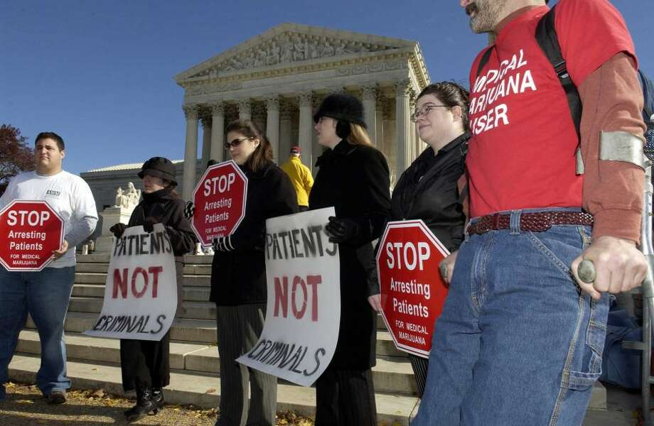 Proponents of medical marijuana hold signs outside of the U.S. Supreme Court November 29, 2004 in Washington, D.C. The court heard arguments over whether the Controlled Substance Act of 1970 is unconstitutional as it applies to the right to cultivate and possess cannabis to treat medical conditions as recommended by a medical doctor. The court upheld the federal government's right to ban the drug.Photo By Mannie Garcia/Getty Images